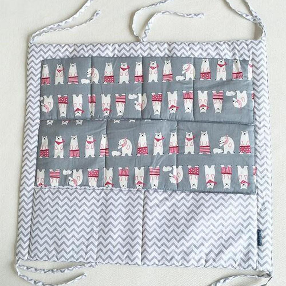 серый органайзер для детской кроватки